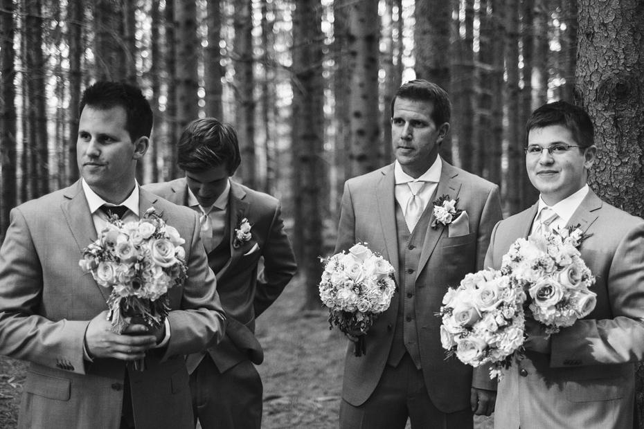 Groomsmen Holding Flowers